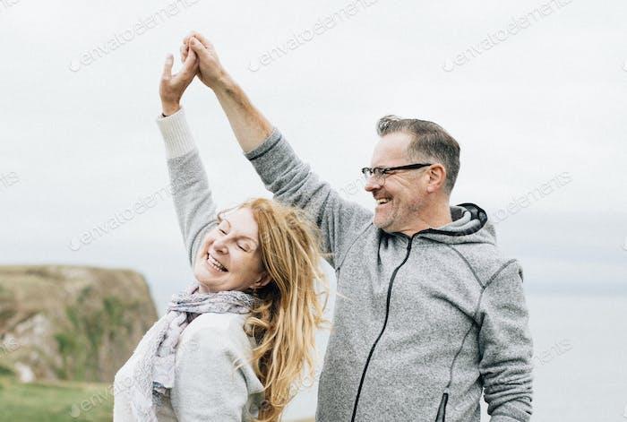 Romantic senior couple dancing outdoors