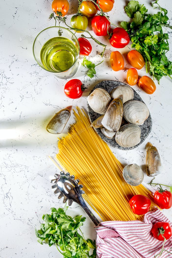 Ingredients for cooking Spaghetti with seafood. Shells musselsa, clams, vongole, tomatoes and white