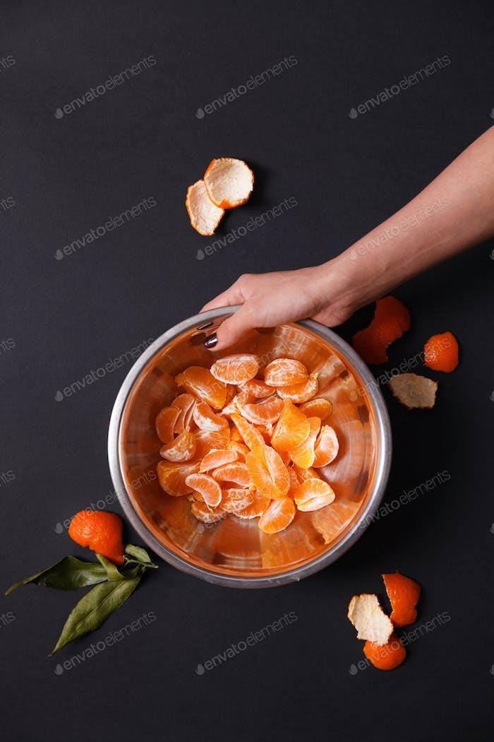Pieces of mandarin in metal dish