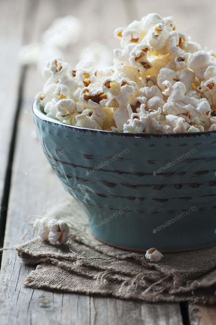 Popcorn and cola on the wooden table