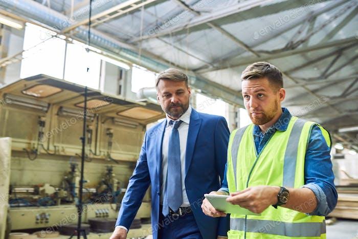 Mature Businessman Inspecting Modern Plant