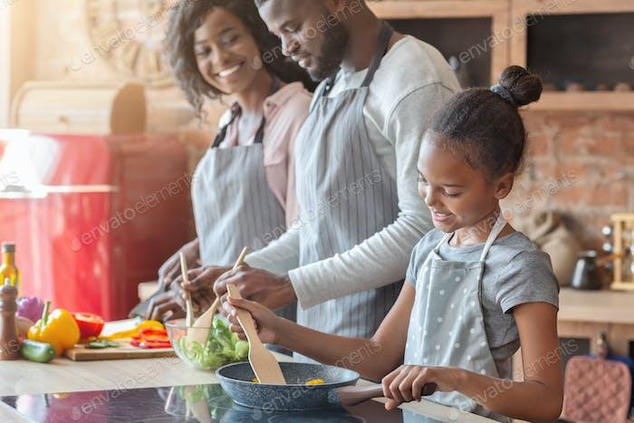 Lovely vegan family making healthy dinner together