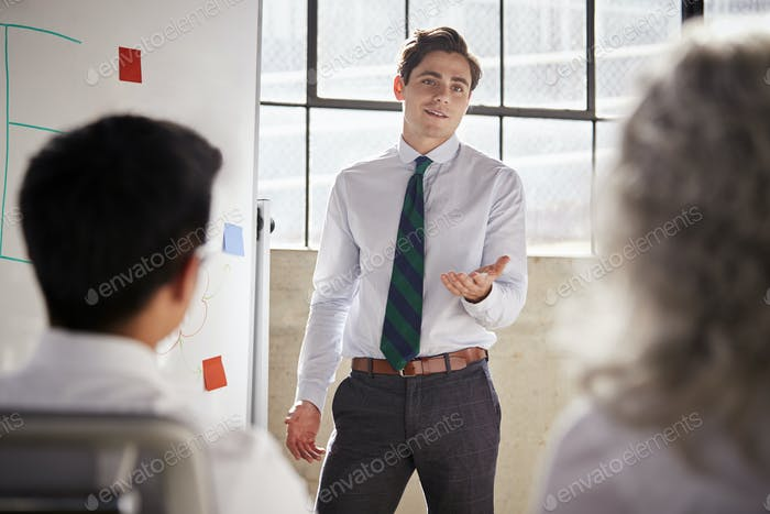 Young white businessman giving a presentation, close up