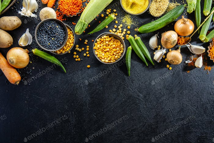 Variety of fresh tasty vegetables on dark background