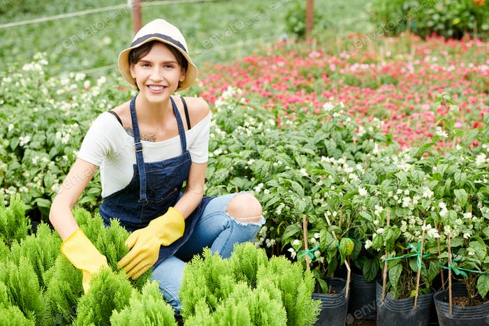 Woman enjoying working with plants and flowers