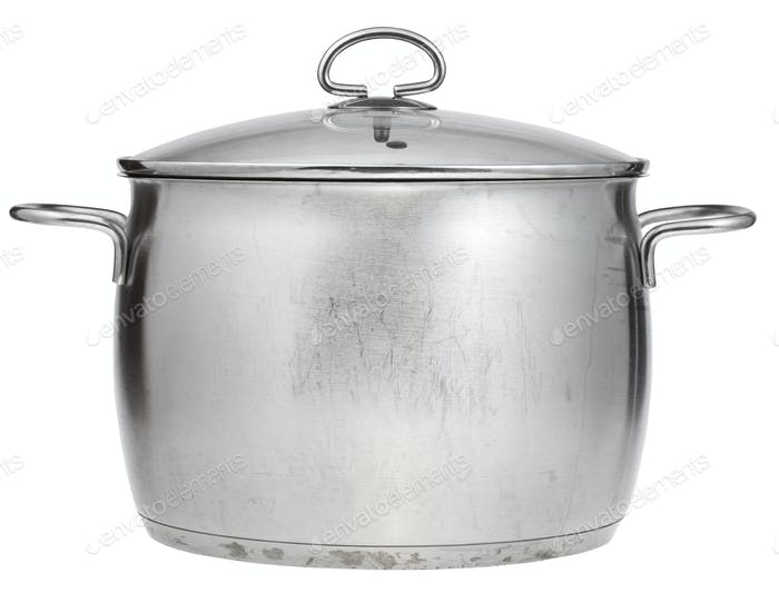 big stainless steel saucepan covered by glass lid