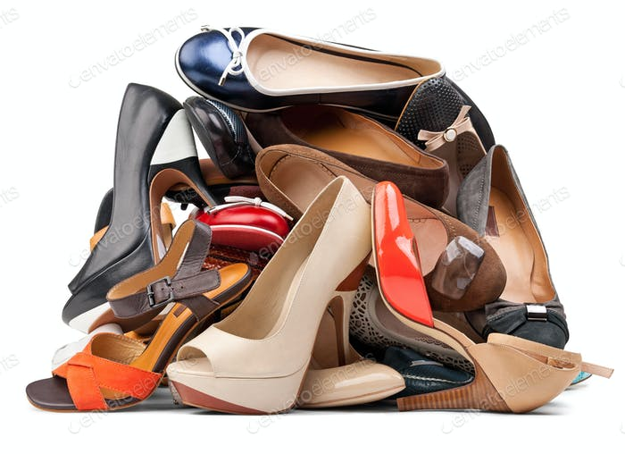 Pile of female shoes over white, with clipping path