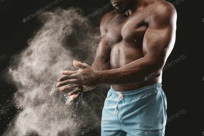Strong black athlete getting ready for training