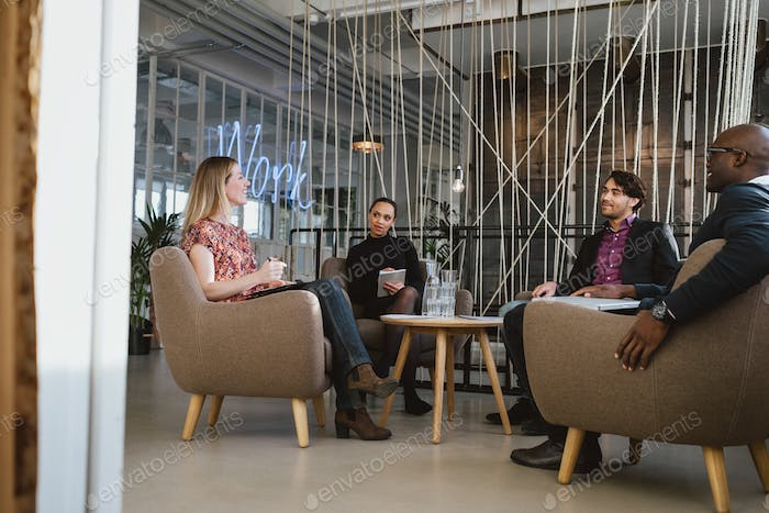 Office workers having a meeting in lobby