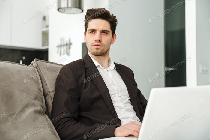 Concentrated young businessman in home