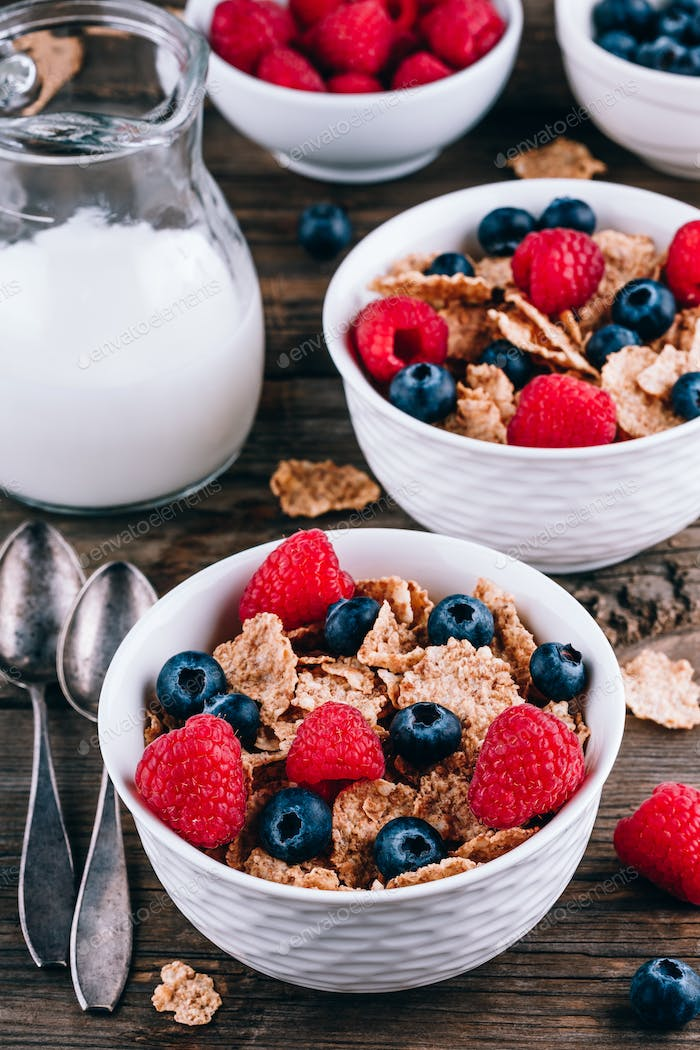 Whole Grain cereals with fresh blueberries and raspberries for breakfast.