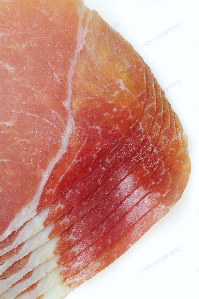 Prosciutto or hamon isolated on a white background