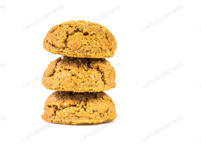 Pile of three traditional pepernoten treats on white background
