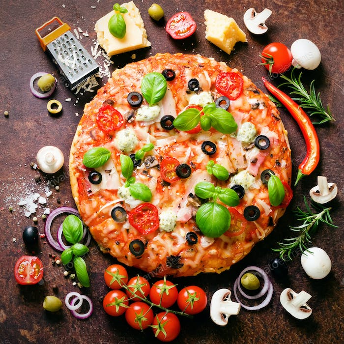 Food ingredients and spices for cooking mushrooms, tomatoes, cheese, onion, oil, pepper, salt, basil