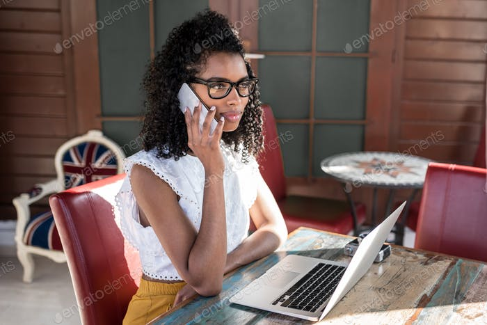 Businesswoman working from home on the mobile phone