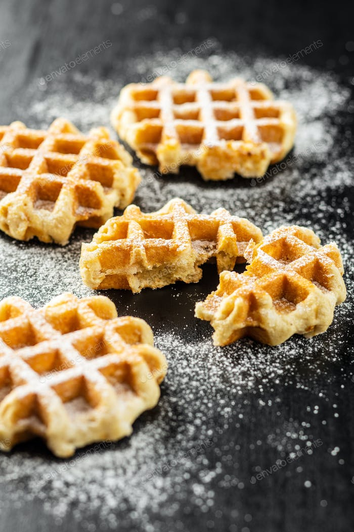 Belgian waffles sprinkled with sugar.