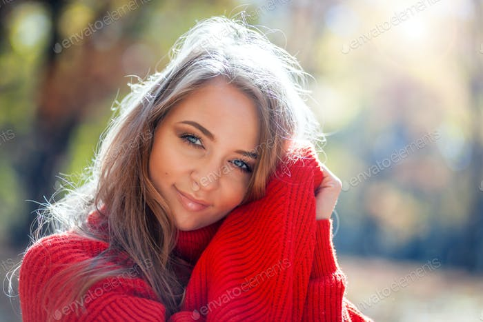Natural woman in soft sweater outdoor, positive emotions