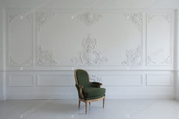 vintage luxury green armchair in white room over wall design bas-relief stucco mouldings roccoco