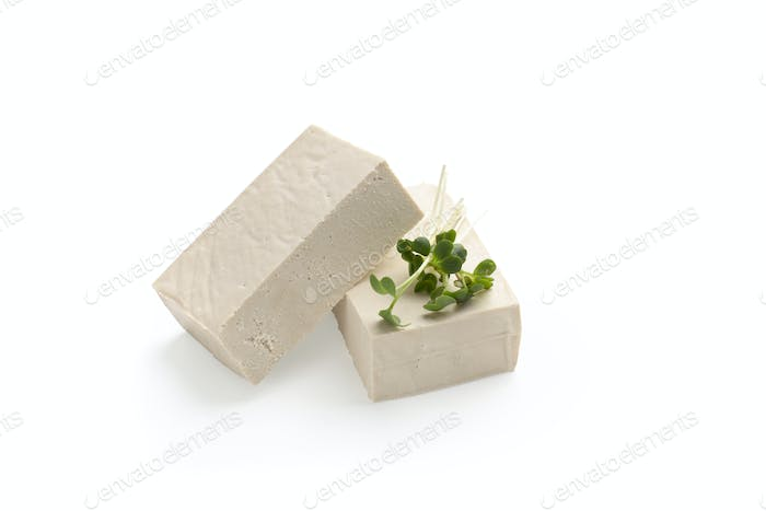 Blocks of Tofu cheese with microgreen leaves