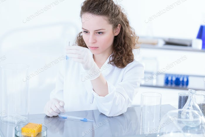 Chemist during laboratory analysis