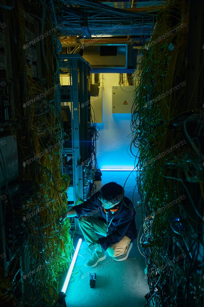 Young Man Working with Network Servers