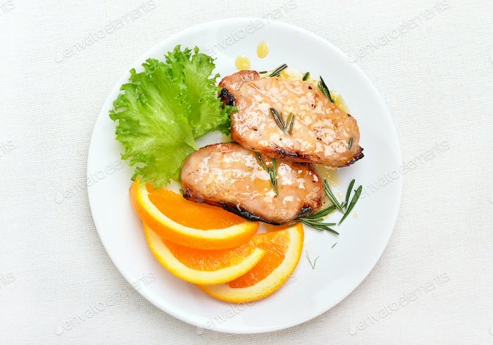 Pork chop with orange sauce