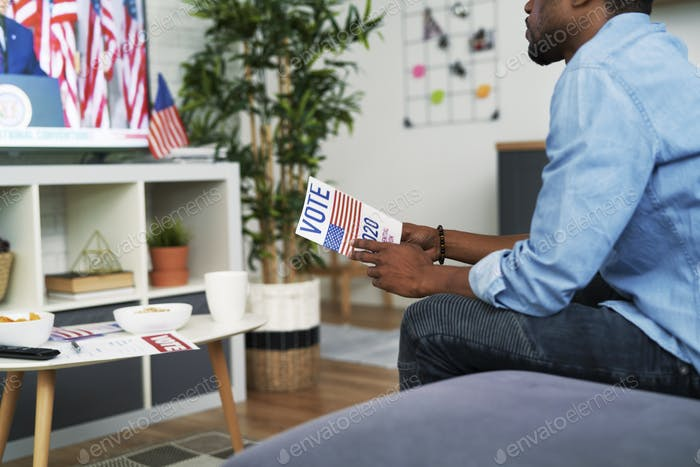 Black man interested in watching TV of USA election