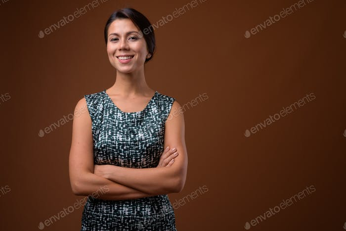Portrait of beautiful multi ethnic businesswoman with hair tied