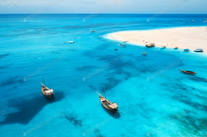 Aerial view of boats on tropical sea coast with sandy beach