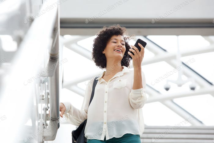 woman in her 30s looking at mobile phone in the city