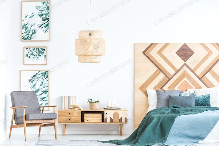 Armchair in rustic bedroom interior