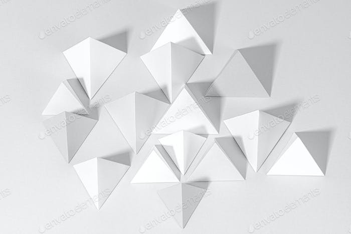 3D gray pyramid paper craft on a gray background