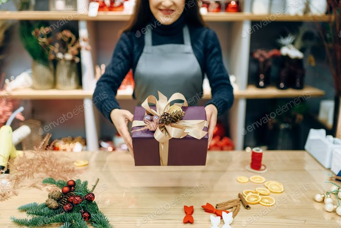 Seller shows gift box with handmade wrapping
