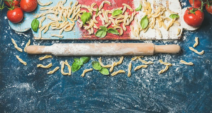 Ingredients for cooking Italian dinner and plunger on colofrul board