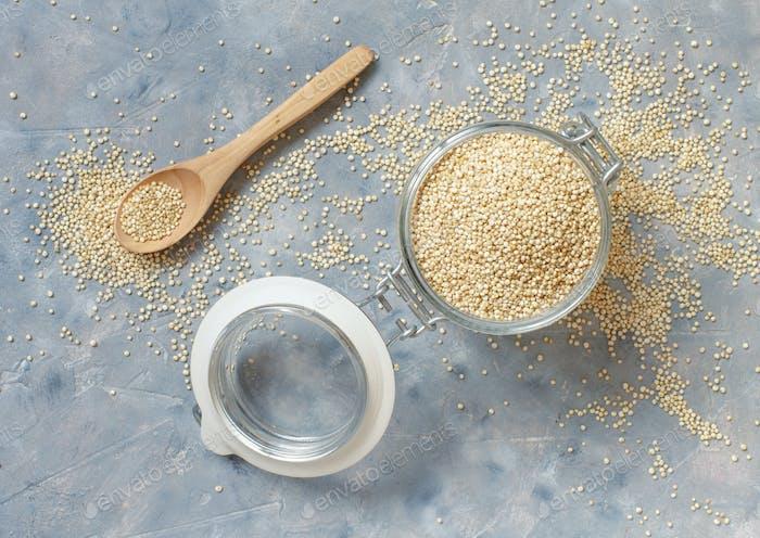 Raw dry white quinoa seeds close up