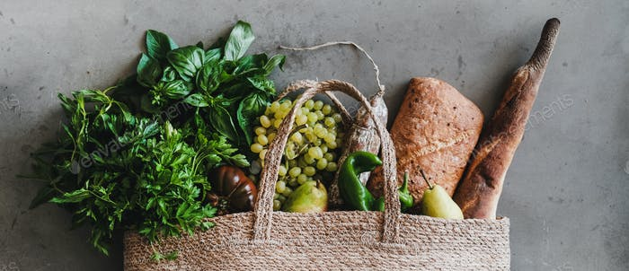 Flat-lay of eco-friendly bag with fresh foods, wide composition