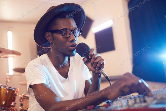 Young Man Writing Music in Studio