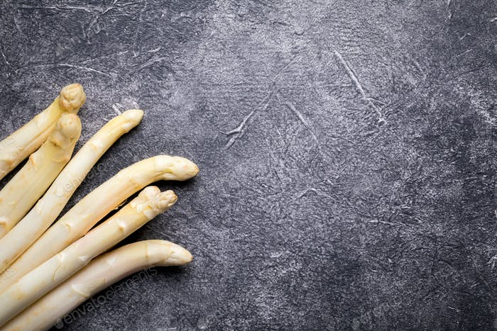 Fresh, white asparagus against a dark background. Healthy eating concept.