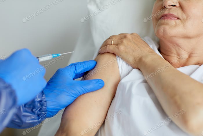 Injecting Antiviral Medicament To Woman