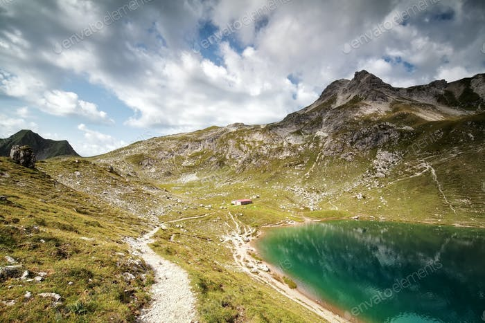 turquoise alpine lake in summer