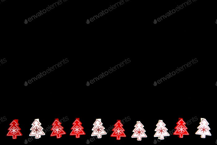 Red and white Christmas fir tree ornaments isolated on black background. Space for text