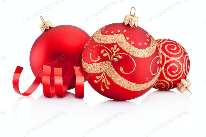 Red Christmas decoration baubles and curling paper isolated on w