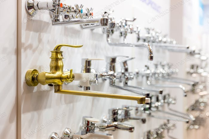 Water faucets on the shelf closeup, plumbing shop