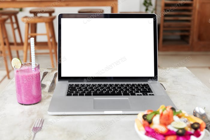 Modern portable laptop computer with blank white copy screen for your promotional text or advertisme
