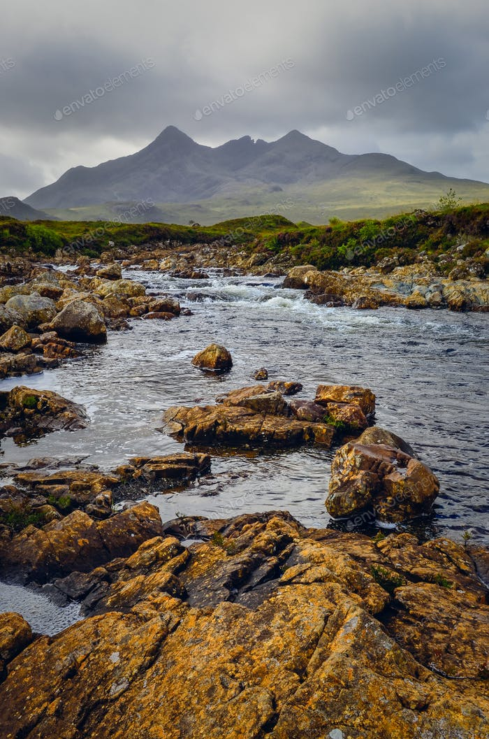 Landscape of Cuillin hills and river, Scottish highlands