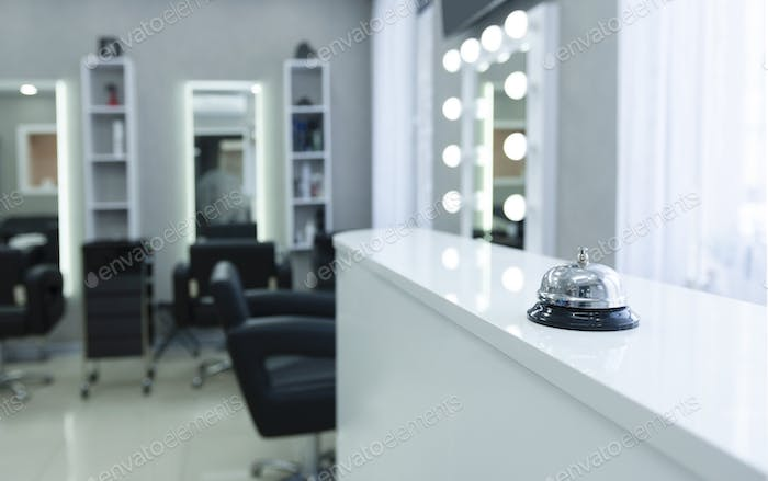 Focus on button to call in beauty salon