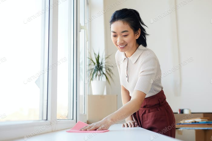 Young Asian Woman Cleaning Home