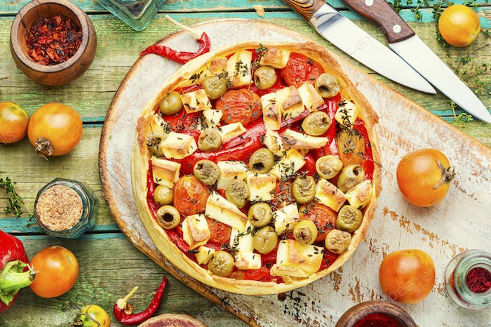Cheese pie with peppers and olives.