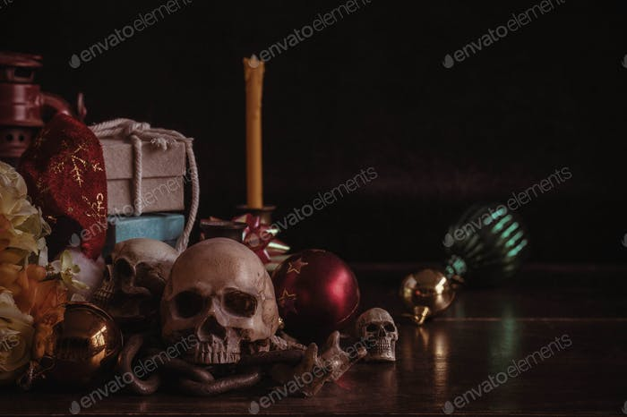 Skull and gifts on wooden.