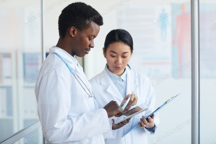 Two Young Doctors in Clinic